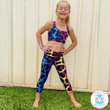 owlete active gymnastics crop top for girls in a fun leopard print design with bold rainbow backdrop squat proof fabrics