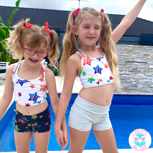 girls wearing super star activewear for kids at the pool better body coverage