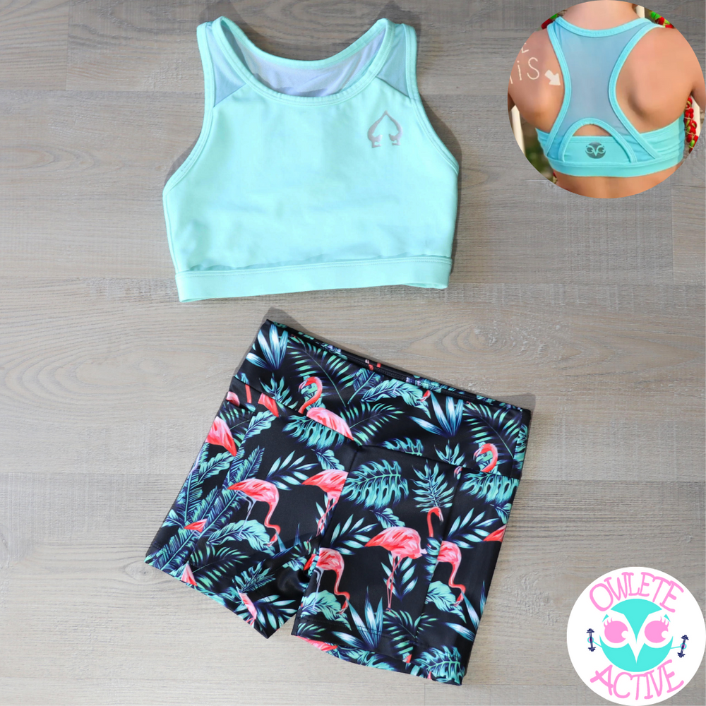 mint green crop top with breathable panels created by a gymnasts for active fit girls to be comfortable and move with ease