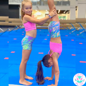 Load image into Gallery viewer, kids gymnastics wear wild rainbow short with swirls of colour like ice cream