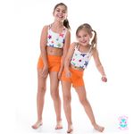 young girls activewear shorts and crop top set bright orange with colourful star pattern
