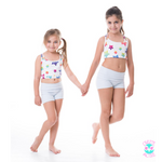 young girls activewear set pastel blue owlete shorts with white star crop top by the pool