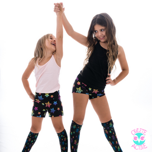 girls wearing black super star shorts and socks happy active kids in activewear