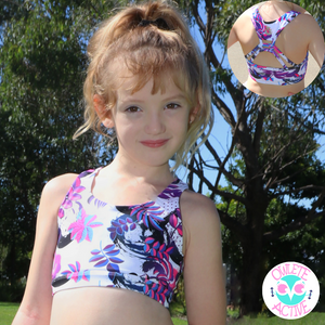 owlete active midnight rainforest crop sports bra for kids firm fitting pretty pink purple and blue