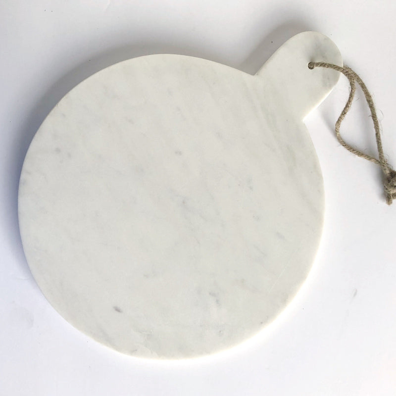 round white marble serving board on barquegifts.com