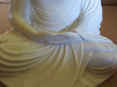 Buddha. Hands Touching = Relatation and meditation.