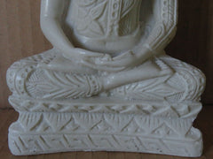 Buudha seated in a lotus postition