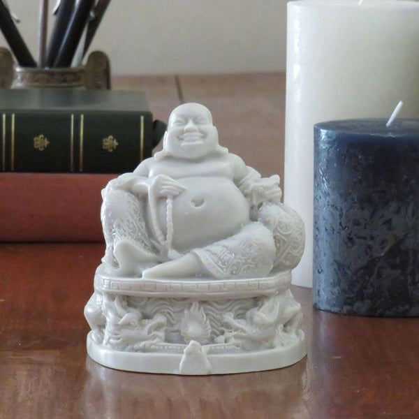 Happy Buddha on a Dragon Base