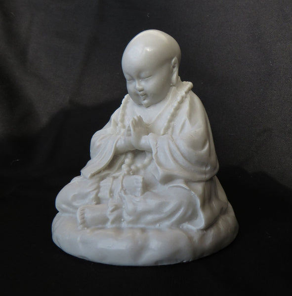 Young Tibetan style, Praying Buddha in reconstituted marble.