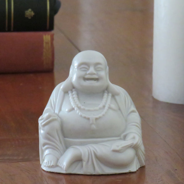 Fat bellied Lucky Buddha with a Bat