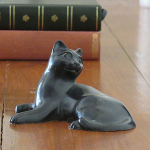 Medium attentive Cat in reconstituted marble