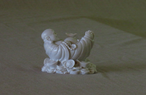 Laid back Chinese style Buddha of good fortune.