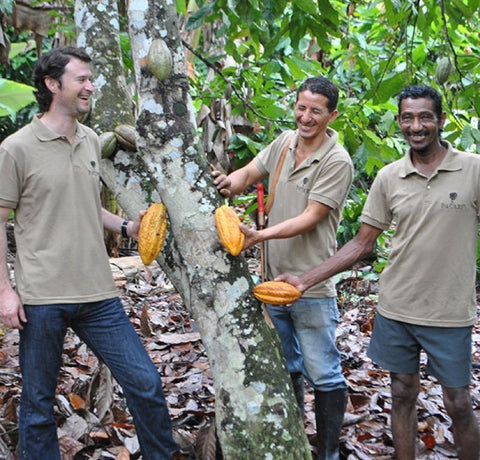 Santiago, CEO of Pacari chocolate with cacao workers
