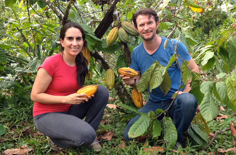 Santiago and Carla of Pacari holding cacao beans
