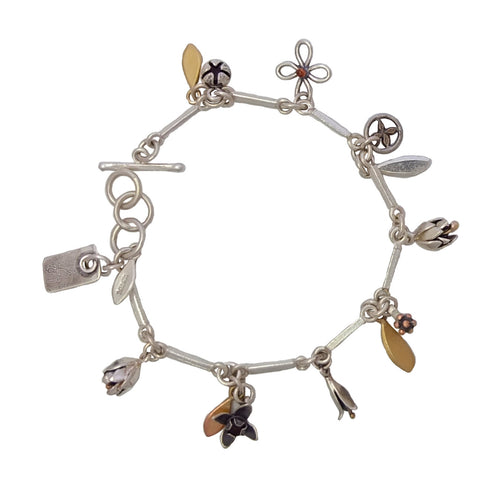 Silver and Gold Birdsong charm bracelet by Martyn Milligan Rinopai Golden Bay
