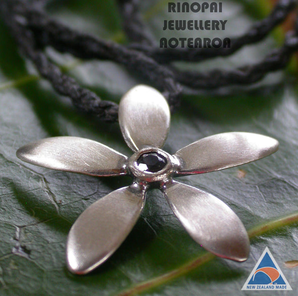 Jewellery NZ | Jasmine Silver Flower Necklace black chord on leaf | Redmanuka