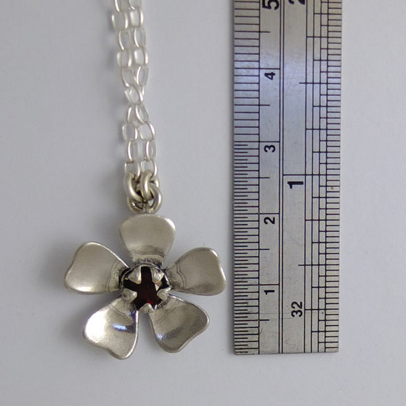 Red Manuka Flower with ruler to show size | Jewellery nz | Redmanuka