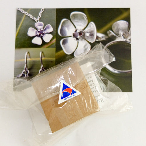 Kanuka Flower Earrings | nz jewellery | Redmanuka, silver earrings with garnet centres in box for quick delivery