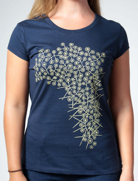 Wattle | Women's short sleeve golden yellow on a navy tee.