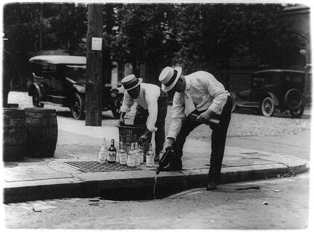 Men disposing liquor