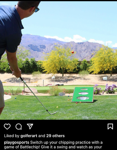 guy practicing golf chipping