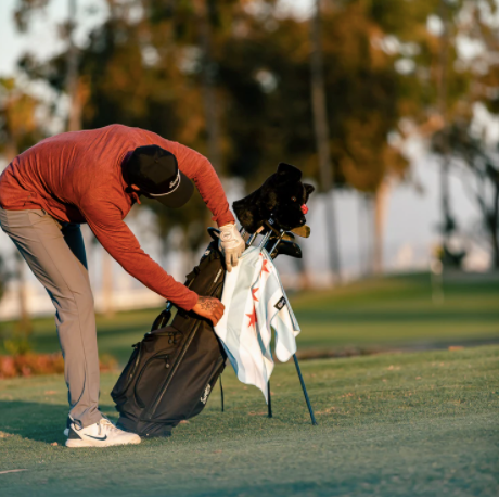example of a golf towel hanging from a golf bag with a slit