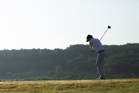 proper golf stance with slight bend of knee example