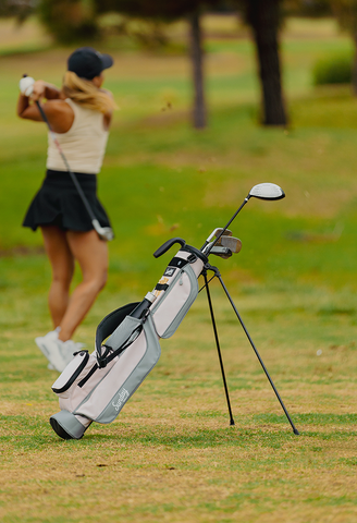woman golfing with a Sunday Golf Loma bag