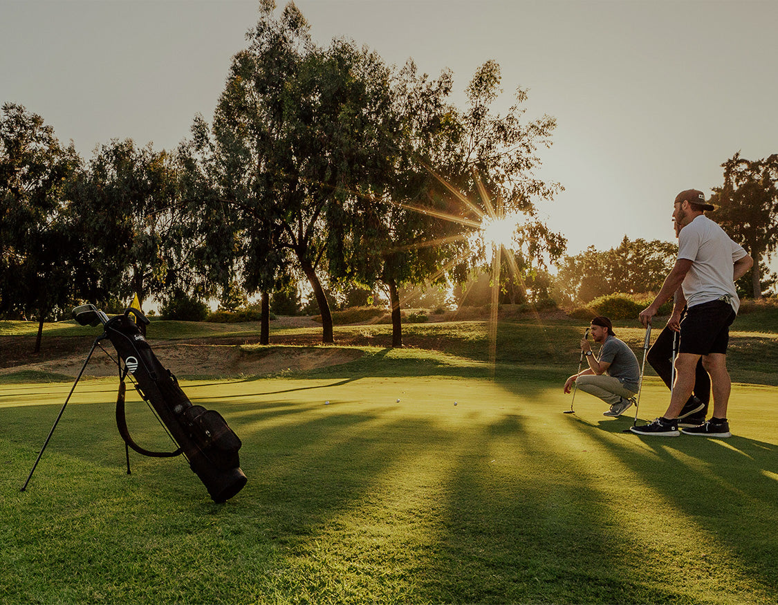 Golfers playing with a Loma Bag on the foreground