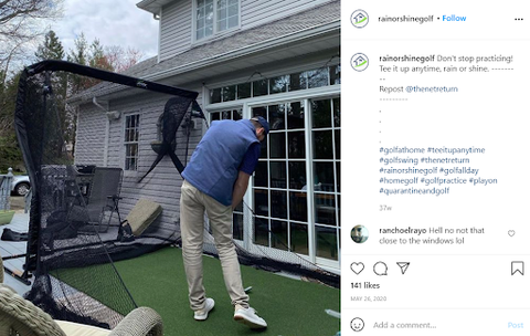 person practicing golf at home with their putting green
