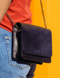 Navy & Black Leather womens handbag. Square shape with a chain strap. Lifestyle product image