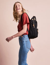 Black & Camel small canvas backpack. Model image