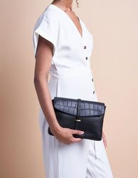 Black Classic & Croco Leather womens handbag. Square shape with an adjustable strap. Model image.