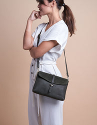 Green Soft Grain & Suede leather womens handbag. Square shape with an adjustable strap. Model image