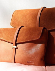 Wild Oak Soft Grain & Suede leather womens handbag. Square shape with an adjustable strap. Lifestyle product image.