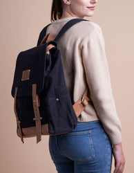 Mau Backpack Black Canvas and Leather. Large travel bag for men and women.  Model image.