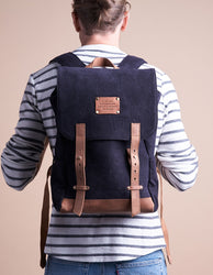 Mau Backpack Black Canvas and Leather. Large travel bag for men and women.  Model image.Mau Backpack Black Canvas and Leather. Large travel bag for men and women.  Model image.