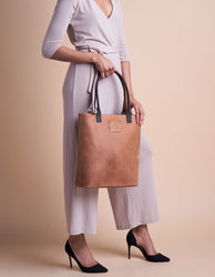 Camel Leather womens handbag. Rectangular leather shopper. Model image.