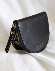 Small Black leather coin purse. Lifestyle image
