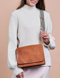 Cognac Leather womens handbag. Square shape with an adjustable strap. Model product image