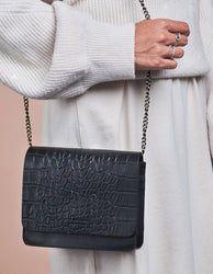 Black Croco Leather womens handbag. Square shape with a chain strap. Model product image