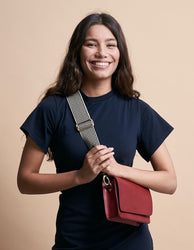 Ruby Leather womens handbag. Square shape with an adjustable strap. Model product image