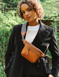 Cognac Leather womens fanny pack. Square shape with an adjustable strap. Lifestyle product image