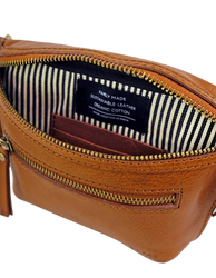 Cognac Leather womens fanny pack. Square shape with an adjustable strap. Inside product image
