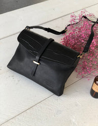 Black Classic & Croco Leather womens handbag. Square shape with an adjustable strap. Lifestyle  image.
