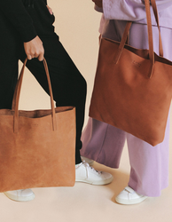 Camel Leather womens shopper bag. Square shape. Lifestyle product image.Camel Leather womens shopper bag. Square shape. Lifestyle product image.