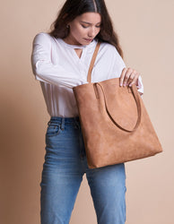 Camel Leather womens shopper bag. Square shape. Model product image.