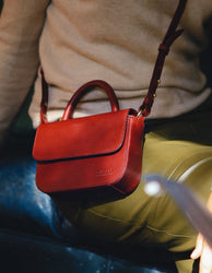Nano Bag Ruby Classic Leather. Small clutch handbag, party bag. Model image.