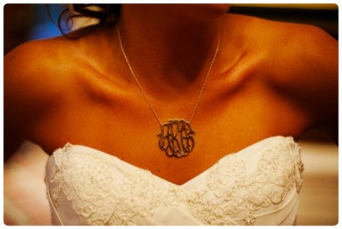 bride wearing gold monogram necklace