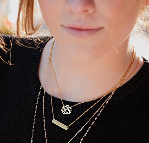 monogram necklaces layered